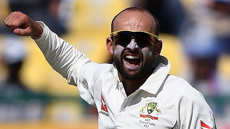 Australia may have failed in their bid to pull off an unlikely victory against India in Adelaide, but Nathan Lyon, who scalped eight wickets in the match, ended the game unbeaten on 38 as he ran out of partners at a venue where he wore overalls as a groundsman eight years ago. (Photo: AFP)