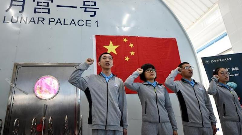 Four students from Beijing University of Aeronautics and Astronautics entered the Lunar Palace-1 on Sunday with the aim of living self-sufficiently for 200 days. (photo: Xinhua)