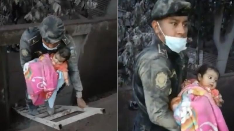 A Police officer saves a baby from Ash house after Volcano erupts - WATCH VIDEO