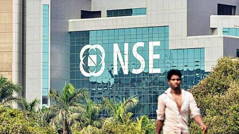 A man walks past the National Stock Exchange, NSE, building in Mumbai's BKC. (Photo: PTI)