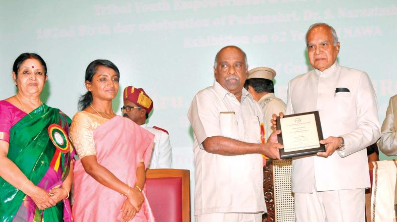 Governor Banwarilal Purohit presented awards to the individuals who contributed towards uplifting tribals in Nilgiris, at the conference on Tribal youth empowerment and entrepreneurship held in Ooty. —DC