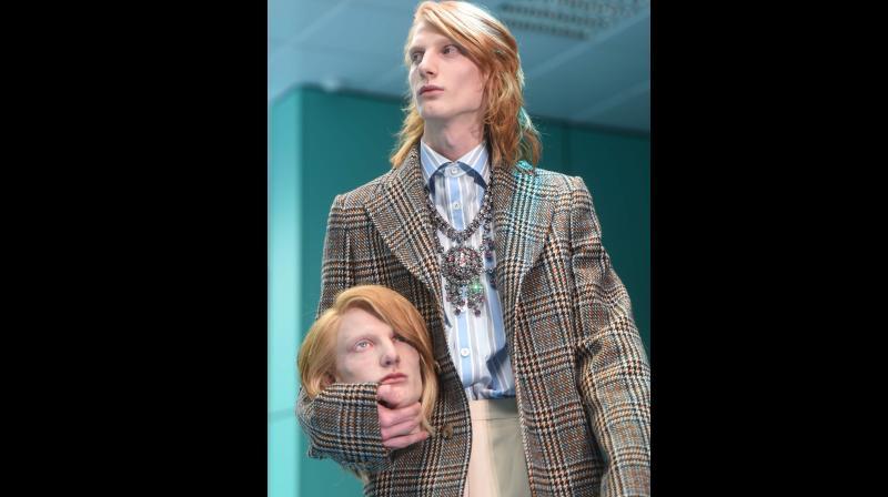 At Milan Fashion Week, models carry fake heads on Gucci catwalk