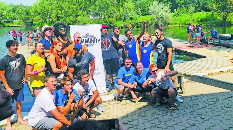 WWE star Becky Lynch (standing, third from left) and Ali (right) pose with rowers from the Ontario Special Olympics after the dragon boat race during a community call at Ashbridge's Bay in Toronto.