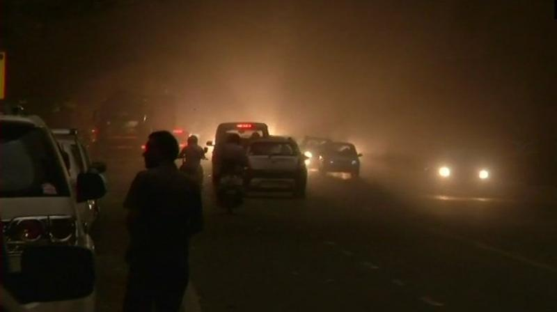 Strong winds with thick dust blew relentlessly across the city before giving way to thunder and lighting and then finally some rain. (Photo: ANI | Twitter)
