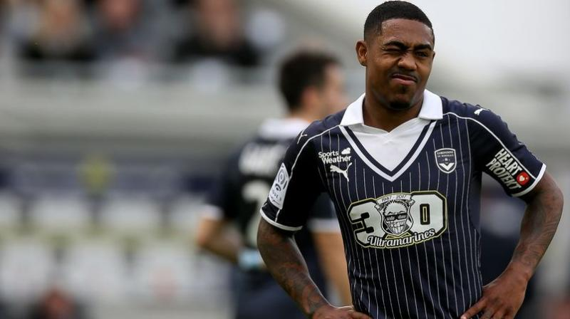 Malcom had been expected to arrive in Rome on Monday night for a medical on Tuesday before joining his future teammates on their pre-season tour of the United States the following day. (Photo: AFP)