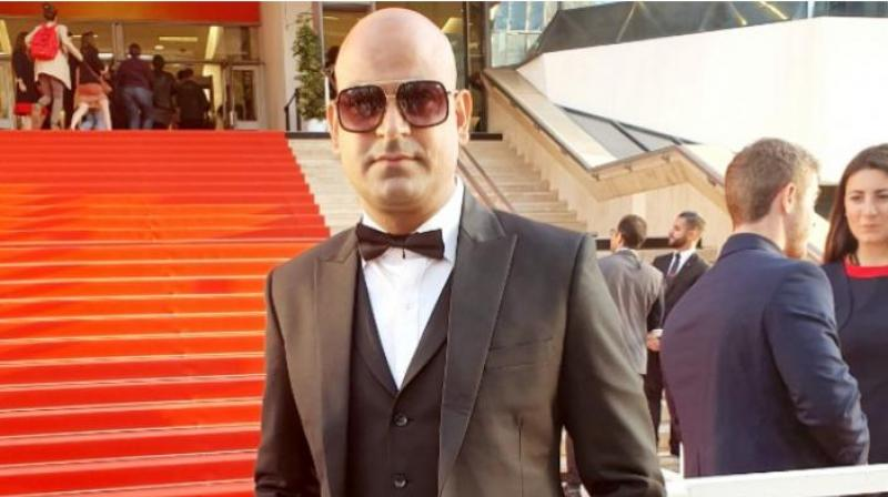 Producer Chanderkant Sharma poses on the red carpet during the promotion of his film 'The Great Indian Casino' at the Cannes 2019 film festival. (Image: Special Arrangement)