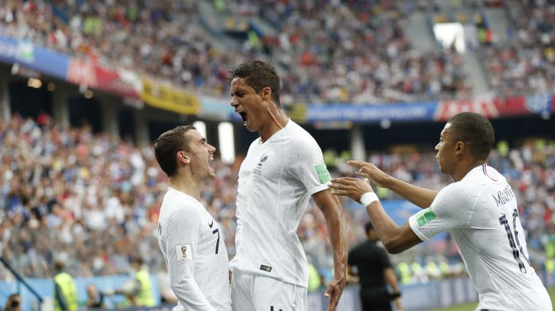 A Raphael Varane header put France in front as they take 1-0 lead at the mid-match break. (Photo: AP)