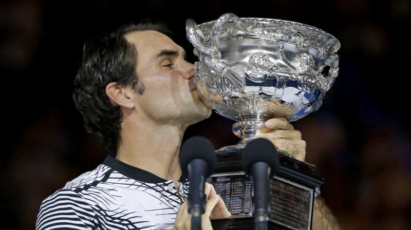 Roger Federer with the Australian Open trophy, his fifth title here in Melbourne. (Photo: AP)