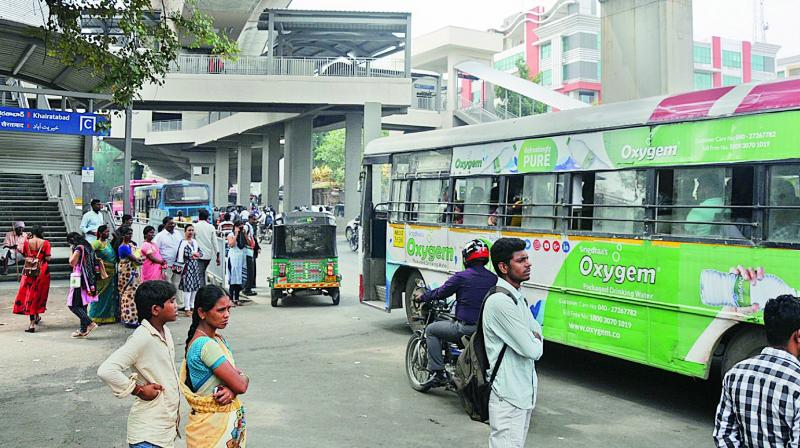 Commuters wait for a bus at the Khairatabad Metro station. (Photos:DEEPAK DESHPANDE)