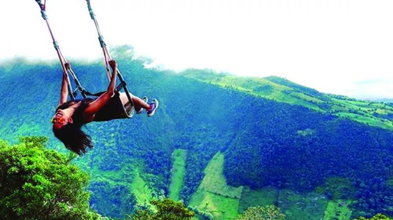 'Swing at the end of the world' in Baños, Ecuador.
