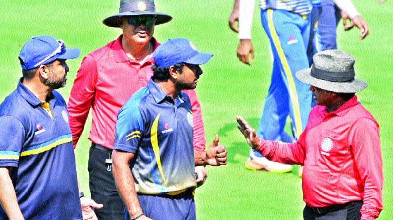Hyderabad captain A. T. Rayudu (centre) argues with the umpire over a controversial decision after their loss to Karnataka in Vizag on Thursday.	(Photo: P. N. Murthy)