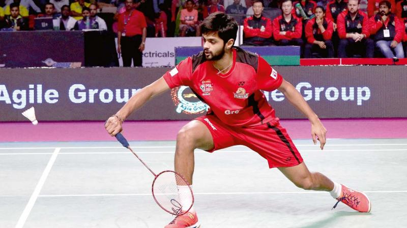 Hyderabad Hunters' Sai Praneeth en route to his 10-15, 15-7, 15-14 win over Chong Wei Feng of Bengaluru Blasters in their PBL match in Hyderabad on Thursday.