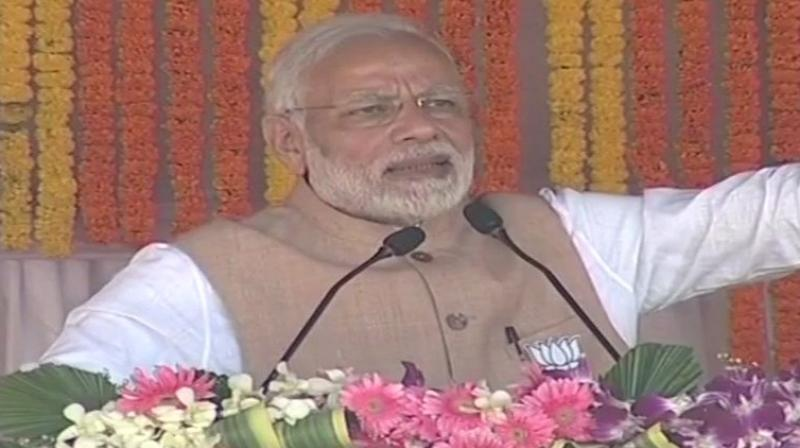 PM Modi urged the people to teach a 'fitting lesson to the Congress leaders'. (Photo: ANI/Twitter)