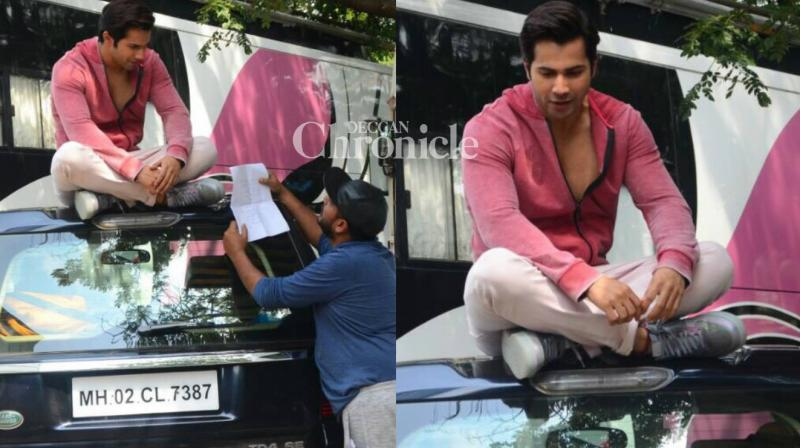 Varun Dhawan was snapped rehearsing his lines on top of a car on the sets of his upcoming film 'Judwaa 2' in Mumbai on Wednesday. (Photo: Viral Bhayani)