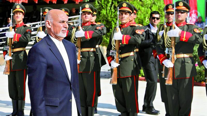 Afghan President Ashraf Ghani inspects the guard of honour during Independence Day celebrations in Kabul on Monday. (Photo: AP)