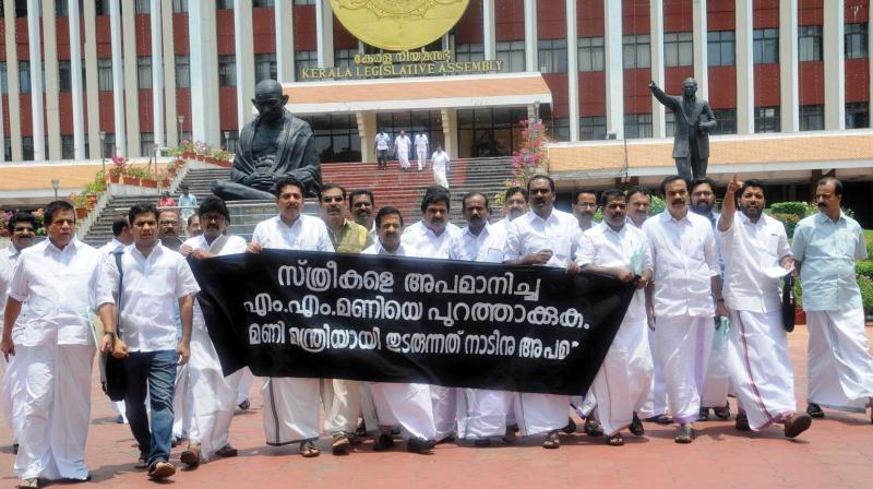 Opposition members take out a march after walking out of the assembly on Tuesday, seeking the ouster of power minister M.M. Mani from the post. (Photo: A.V. MUZAFAR)