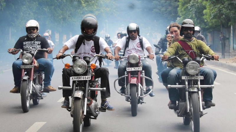 Bikers enroute to Rasta Cafe Jawa Day.