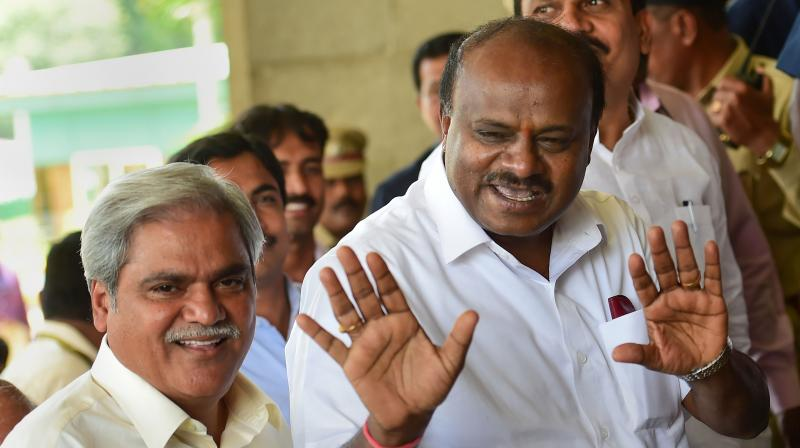 Karnataka Chief Minister H.D. Kumaraswamy arrives to attend the Assembly Session, at Vidhana Soudha in Bengaluru on Friday.  (PTI)