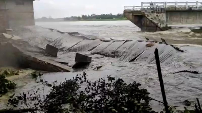 A TV grab shows a school getting washed away in gushing river waters in Assam on Friday.