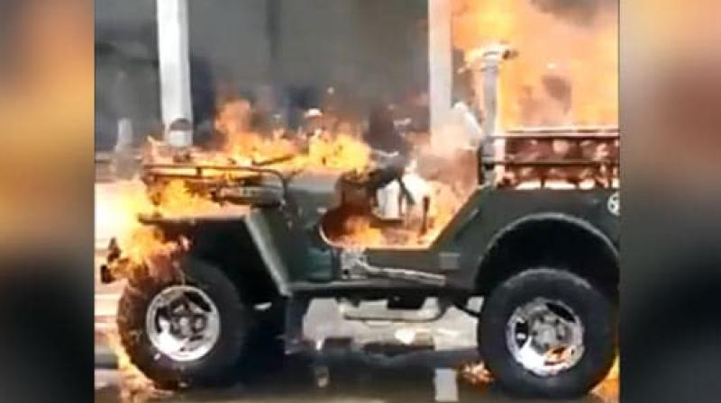 In the video, a man clad in gold jewellery can be seen pouring petrol on his own jeep and then setting it ablaze by throwing a lit matchstick on the vehicle. (Photo: Twitter/ @dineshjoshi70)