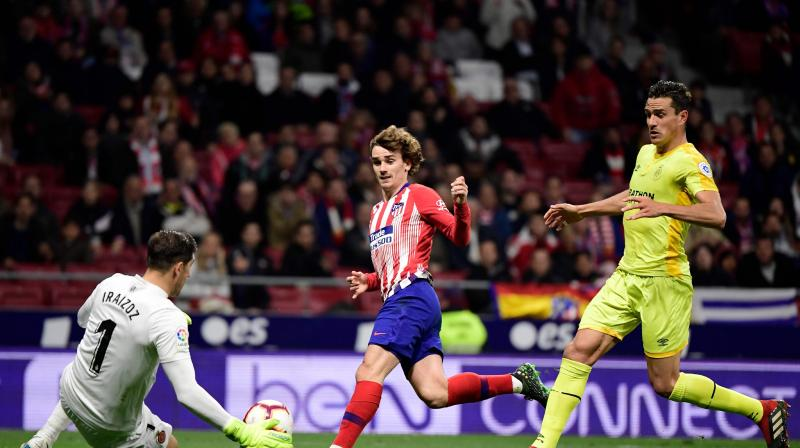 Barca host Atletico in a top-of-the-table clash on Saturday, where a win for the Catalans could effectively end the title race. (Photo: AFP)