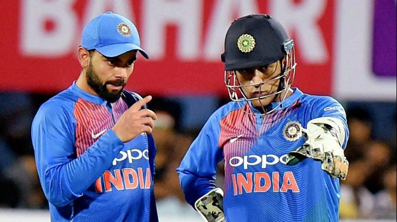 Former India skipper MS Dhoni was caught on stump mic advising, encouraging and lauding Kedar Jadhav, current Team India captain Virat Kohli, Dinesk Karthik and co during the second ODI versus New Zealand in Pune. (Photo: PTI)