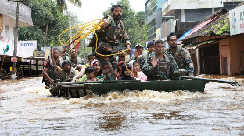 Army personnel evacuate local residents in Aluva, Kochi. (Image: ARUN CHANDRABOSE)