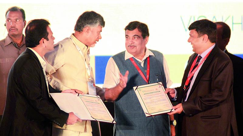 Representatives of CRDA and NHAI signed MoUs in the presence of Chief Minister N. Chandrababu Naidu and Union minister Nitin Gadkari during the CII Partnership Summit in Visakhapatnam on Saturday. (Photo: DC)