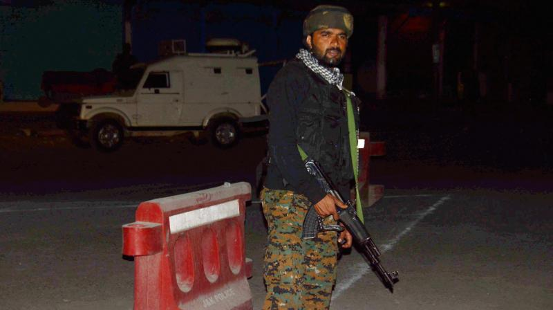 Security person stand guard after militants opened fire on the Amarnath Yatra in which some pilgrims were killed many injured in Anantnag in Jammu and Kashmir on Monday. (Photo: PTI)
