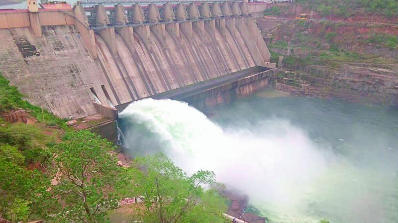 Water flows from Srisailam project after opening of a sluice gate. 2 TMC water released for drinking water purpose on Saturday. (Photo: DC)