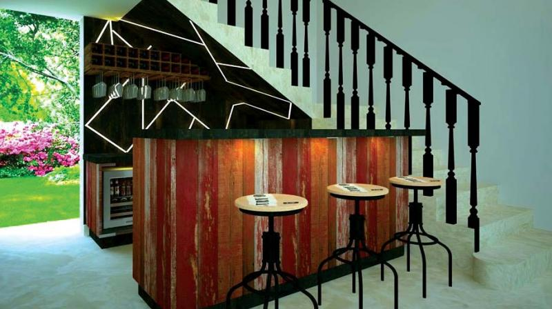 Space well-utilised by turning the area under the stairs into a bar.