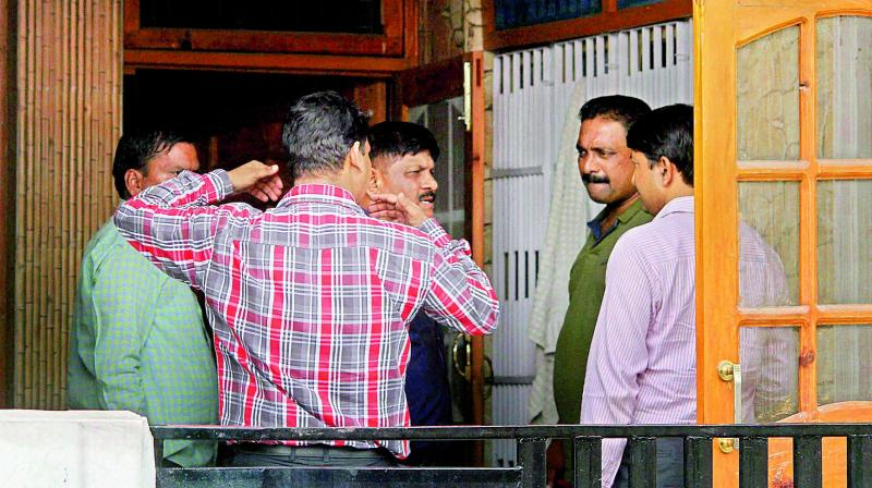 NIA officials during the raid on the residence of Devinder Singh Behal, an aide of separatist leader Syed Ali Shah Geelani, in Jammu on Sunday. (Photo: PTI)