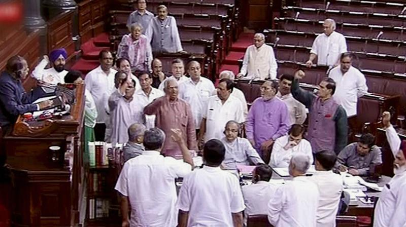Opposition members protesting in the Well of Rajya Sabha in the Parliament, New Delhi on Monday. (Photo: PTI)
