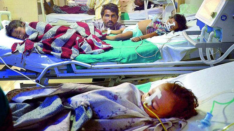 Children admitted in the state-run Baba Raghav Das Medical College in Gorakhpur on Saturday. (Photo: PTI)
