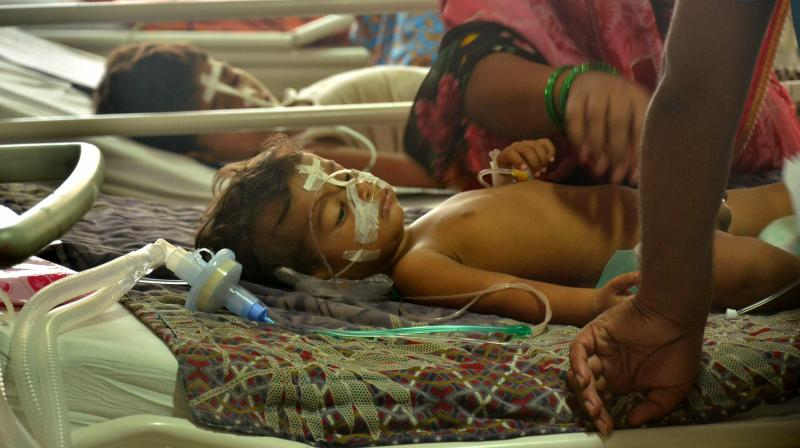 Children receive treatments in the Encephalitis Ward at the Baba Raghav Das Medical College Hospital where over 60 children have died over the past one week, in Gorakhpur district on Monday. (Photo: PTI)