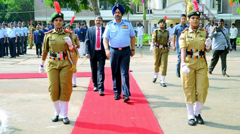 Chief of Air Staff Air Chief Marshal Birender Singh Dhanoa receives a guard of honour by NCC cadets on his arrival at the AU Campus in Visakhapatnam on Friday. (Photo: DC)