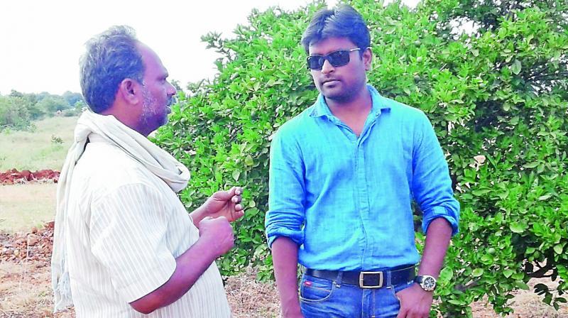 Aneel Kumar with a farmer.