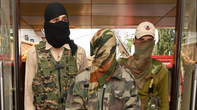 Hizb-ul-Mujahideen militant Adil Hussain being presented at a joint press conference of Army and CRPF in Srinagar on Monday. (Photo: PTI)