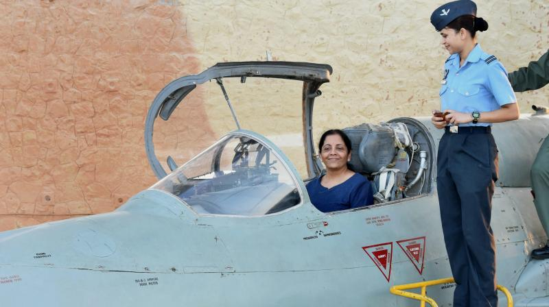 Union Defence Minister Nirmala Sitharaman inside the cockpit of MIG-21 Biscon during her visit to Air Force Station Uttarlai in Gujarat on Sunday.  (Photo: PTI)