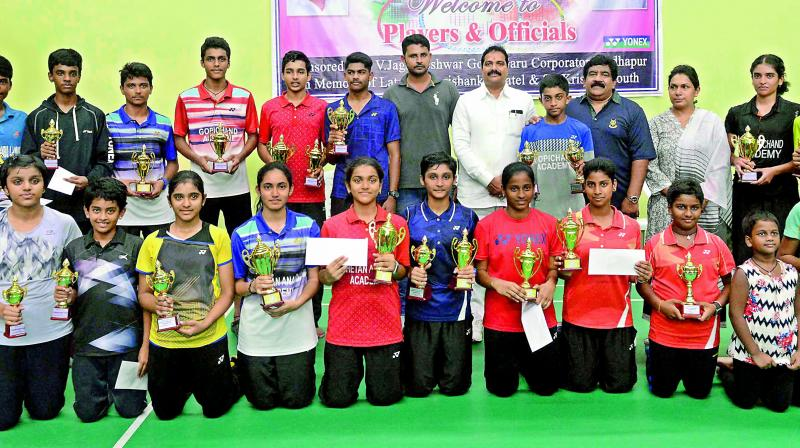 Winners and runners-up pose with the trophies after the conclusion of the 3rd Telangana State Sub-Junior (boys & girls) Badminton Championship that was played at the Sri Fit Pro Badminton House in Serlingampally.