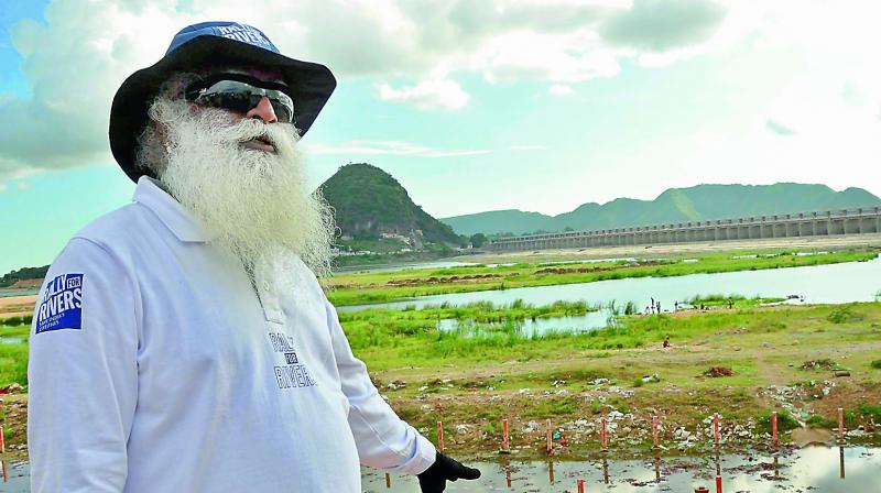 Founder of the Isha Foundation Jaggi Vasudev inspects the Krishnaveni pushkar ghat on Tuesday.