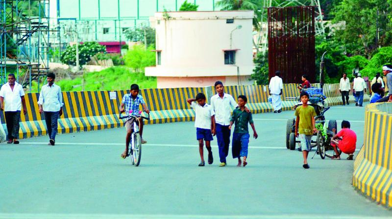 People are barred from using even a two-wheeler on the newly laid flyover near Kanakadurga temple in Vijayawada on Monday. (Photo: DC)