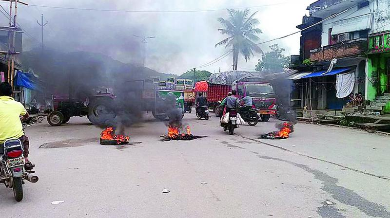 Tires and other items being burnt in the middle of the road in Malkangiri. 	(Photo: DC)