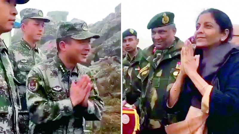In this combo picture of the two stills taken from a video by defence minister Nirmala Sitharaman, she is seen interacting with the Chinese soldiers at the border at Nathu La in Sikkim on Saturday. (Photo: PTI)