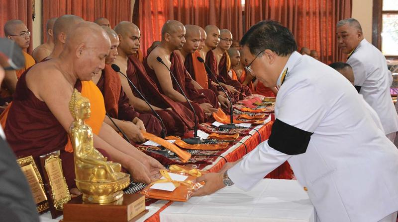 Vitavas Srivihok, Deputy Permanent Secretary, Ministry of Foreign Affairs, Thailand offering the Royal Kathina Civara (special robe) to Buddhist monks at a function organised by the Maha Bodhi Society, Bengaluru.
