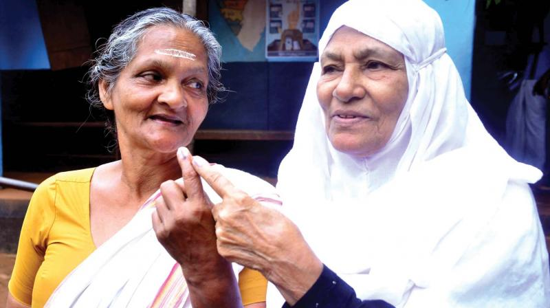 Women show their hands marked with ink to show they had voted in the Vengara bypoll on Wednesday. (Photo: By arrangement)