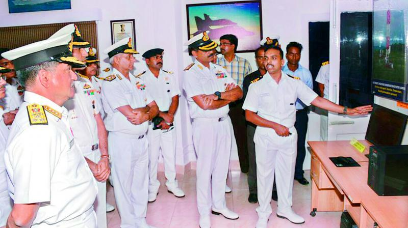 Commander-in-Chief of Eastern Naval Command goes around the Integrated Automatic Aviation Meteorological System (IAAMS) after the inauguration at INS Dega, the Naval Air Station in Visakhapatnam on Friday.