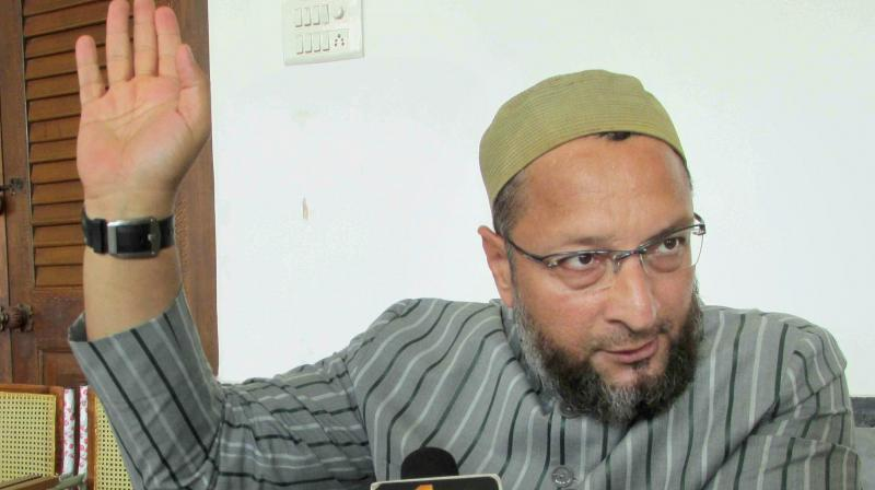 AIMIM chief Asaduddin Owaisi addressing the media in Hyderabad on Tuesday. (Photo: PTI)