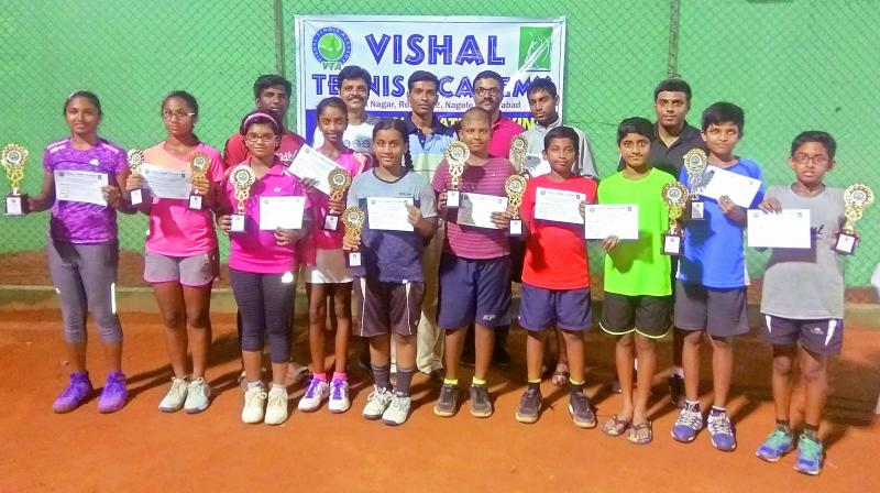 The winners and runners-up pose with trophies and certificates secured in the TSTA Ranking tournament played at Vishal Tennis Academy at Nagole in Hyderabad.