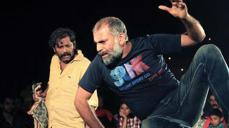 A scene from the play Suddha Madhalam performed at Theruvarangu (file photo).
